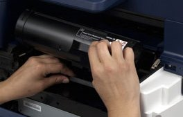 Hands grasping the Xerox toner form USA Copier lease